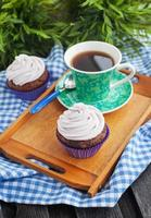 Cupcake and cup of coffee photo