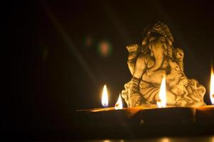 lord ganesha in lamplight