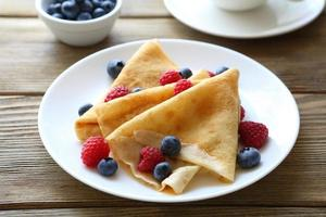 crepes with raspberries, blueberries,