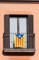 Flag of Catalonia on the balcony photo