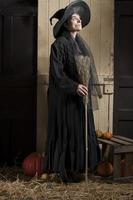 old halloween witch with broom and pumpkins photo