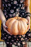 Closeup of girl holding a pumpkin
