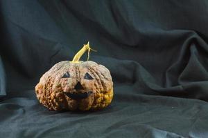 Human skulls and pumpkin on black background, Halloween day background.