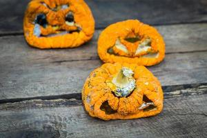 Old halloween pumpkin on wood photo