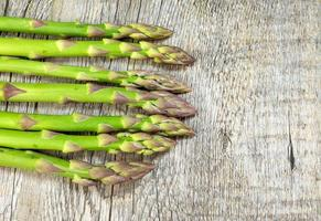asparagus on wooden table photo