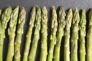 fresh asparagus on black slate