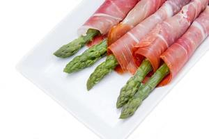 Asparagus and ham on tray close