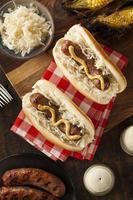 Homemade bratwurst with sauerkraut and mustard
