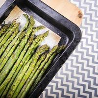 Asparagus spears on a broiler tray. photo