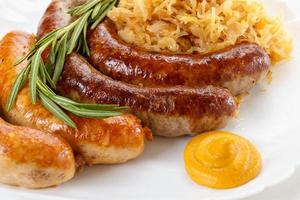 Traditional Oktoberfest menu, plate of sausages and sauerkraut