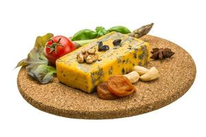 Gold cheese with mould photo