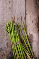 Asparagus on wooden background