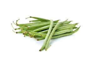 stack of fresh needle beans with stem on white background photo