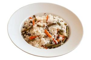 Rice with fried green beans and young carrots photo