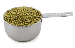 Green mung beans in a measuring cup photo
