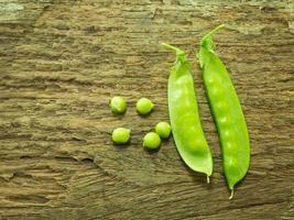Fresh green pea on wood background