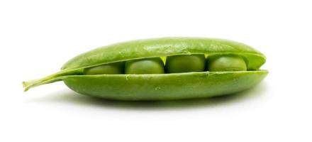 Green shelled unopen pea pod isolated on white photo