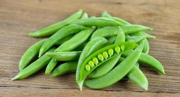 Fresh green beans on wood background photo