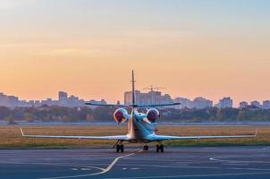 Business jet on the apron for aircraft. The plane against photo