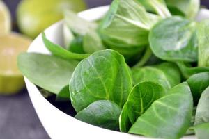 Close up of fresh salad leaves with lime photo