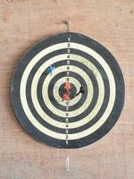 The old target with darts in the center