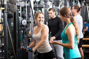 Active people having weightlifting training photo