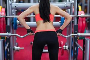 Sport woman exercising gym, fitness center photo