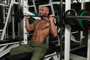 Shoulder Exercises On A Smith Machine photo