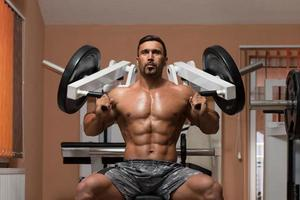 Bodybuilder Exercising Shoulders photo