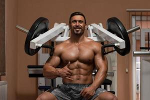 Bodybuilder Doing Exercise For Shoulders photo