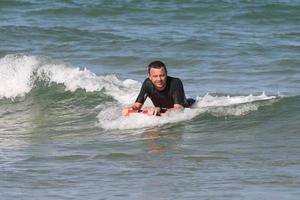 Man surfing wave