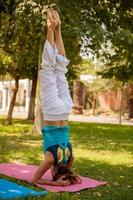 Headstand yoga pose outdoors photo