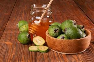 Feijoa Fruits and bank of honey photo