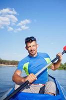 Young man kayaking photo