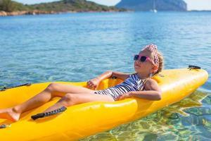 Little beautiful cute girl enjoy kayaking photo