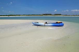 Kayak on the beach photo