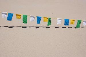 row of rectangle shaped pennants on pavement photo