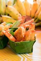 Thai deep fried sliced banana in leave vessel