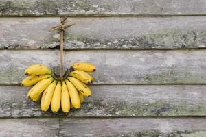Banana hanging on old wooden wall.