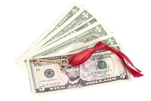 Key to success on  dollar banknotes photo