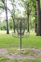 Frolfing (Disc Golf) Basket In A Public Park photo