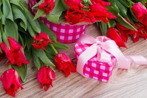 bunch of tulips with present box photo