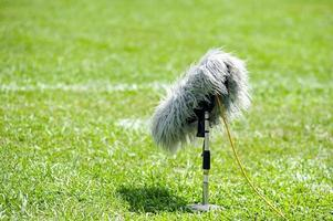 selective focus of professional sport microphone on grass photo
