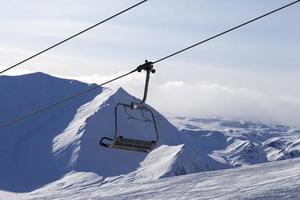 Chair lift and mountains in evening