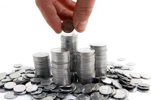 Hand adding coins photo