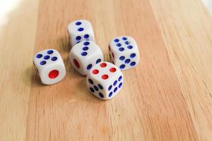 Dices on wood background