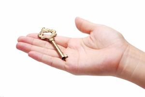 hand holding golden key isolated on white background.
