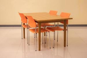 Meeting table and orange chairs