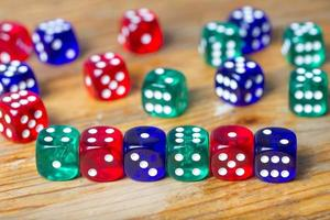 colorful dices background on wood photo