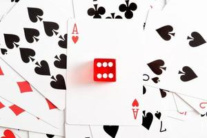 Poker cards and red dice photo